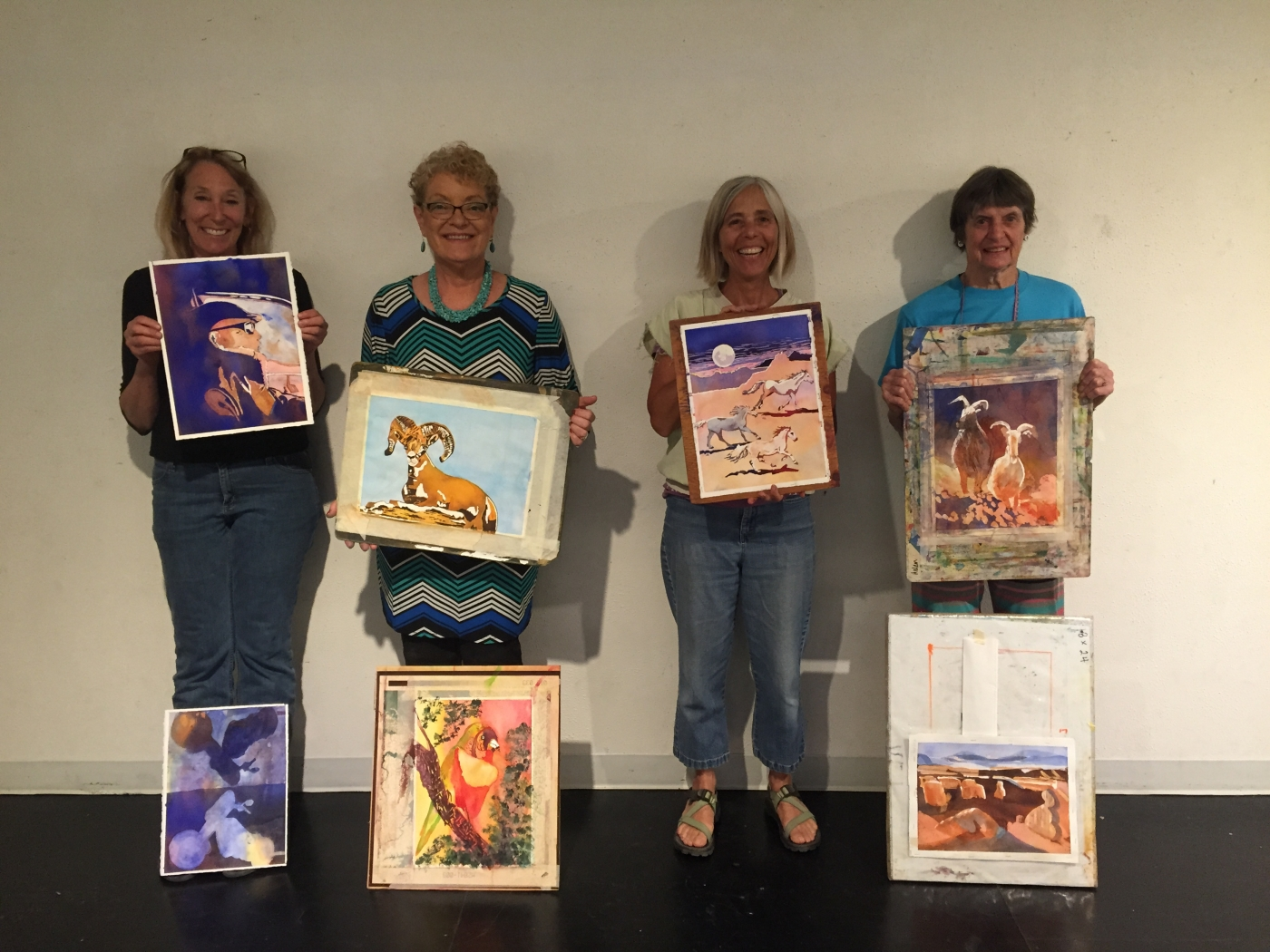Each participant finished two paintings and had a third painting in progress to explore and finish at home.