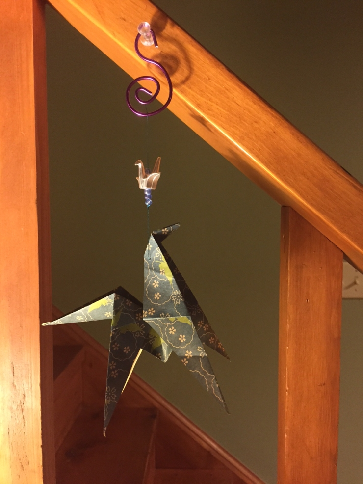 origami horse from imported Japanese papers,, copper wire, metallic thread, glass beads, and metallic crane charm.  Made from a variety of papers, wires, and beads.  No two alike- state color preference.  $10